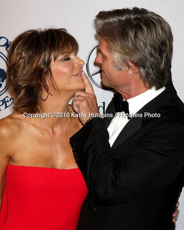 LOS ANGELES - OCT 23:  Lisa Rinna, Harry Hamlin arrives at the 2010 Carousel of Hope Ball at Beverly HIlton Hotel on October 23, 2010 in Beverly Hills, CA
