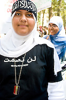 Protester Hoda Zawam poses for a photo in New York City on August 29, 2006 to before marching against Israel's actions during the 2006 Lebanon conflict, a 34 day affair that resulted in over 1,000 Lebanese deaths, the majority of which were civilians.  Israeli casualties numbered over 100 with the majority being in the military.