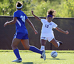 SIOUX FALLS, SD - SEPTEMBER 5: Elisa Martínez #10 from the University of Sioux Falls puts a shot on goal as Carly Brown #34 from Nebraska Kearney defends in the first half of their game Friday evening in Sioux Falls.  (Photo by Dave Eggen/Inertia)