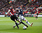 Chris Basham of Sheffield Utd turns Shaun Williams of Millwall during the championship match at the Bramall Lane Stadium, Sheffield. Picture date 14th April 2018. Picture credit should read: Simon Bellis/Sportimage
