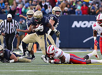 Annapolis, MD - November 11, 2017: Navy Midshipmen fullback Chris High (33) gets tackled by Southern Methodist Mustangs linebacker Kyran Mitchell (11) during the game between SMU and Navy at  Navy-Marine Corps Memorial Stadium in Annapolis, MD.   (Photo by Elliott Brown/Media Images International)
