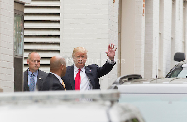 Republican Presidential Candidate Donald Trump, the presumptive Republican Party nominee for President of the United States, waves as he arrives for a meeting with Speaker of the US House Paul Ryan (Republican of Wisconsin) at the National Republican Congressional Committee Headquarters in Washington, DC, May 12, 2016. <br /> Credit: Chris Kleponis / CNP/MediaPunch