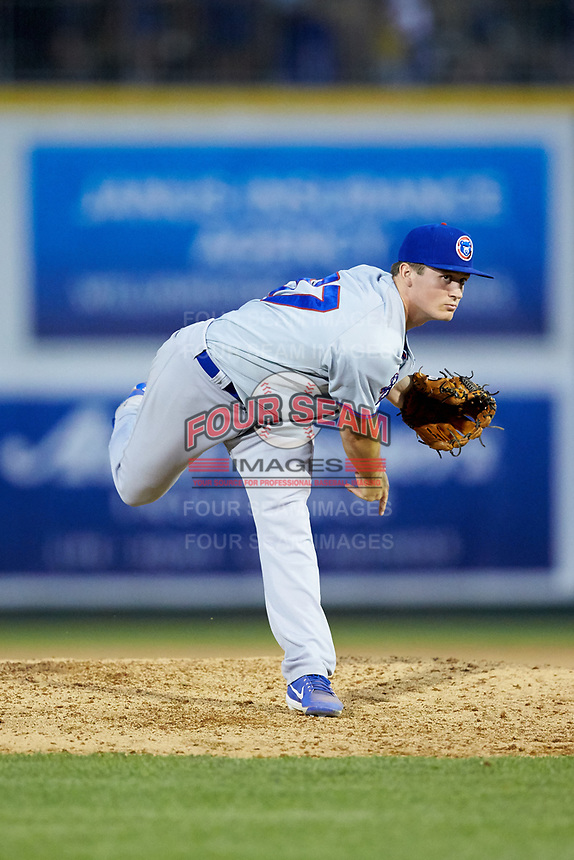 South Bend Cubs relief pitcher Garrett Kelly (37) follows through on his delivery against the Lansing Lugnuts at Cooley Law School Stadium on June 15, 2018 in Lansing, Michigan. The Lugnuts defeated the Cubs 6-4.  (Brian Westerholt/Four Seam Images)
