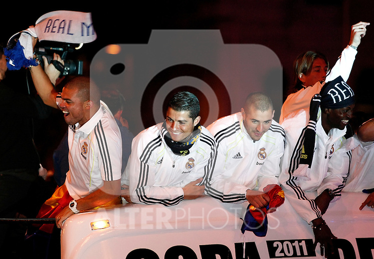 Real Madrid's fltr Pepe, Cristiano Ronaldo, Karim Benzema,  Emmanuel Adebayor and Sergio Ramos celebrate during King's Cup celebration at Cibeles Square in Madrid. April 21, 2011. (ALTERPHOTOS/Julian Bird)