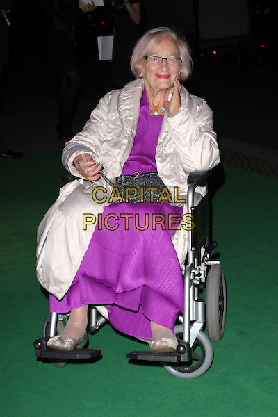 LIZ SMITH.The Specsavers Spectacle Wearer Of The Year 2009 Grand Final at Victoria & Albert Museum, London, England..October 27th, 2009.V&A full length purple dress  white puffa jacket coat sitting wheelchair glasses.CAP/AH.©Adam Houghton/Capital Pictures.