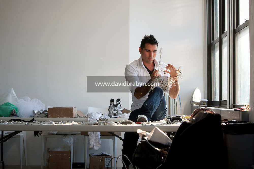 Jeweler to the stars Rodrigo Otazu adjusts a piece of his artwork during a photo shoot in New York, 8 November 2009.