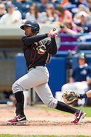 Teoscar Hernandez (4) of the Quad Cities River Bandits follows through on his swing against the West Michigan Whitecaps at Fifth Third Ballpark on May 5, 2013 in Comstock Park, Michigan.  The River Bandits defeated the Whitecaps 5-4.  (Brian Westerholt/Four Seam Images)