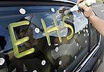 Janelle Gottier decorates her car, prior to the Ellington High School graduation ceremony, June 10, 2016, in Ellington. (Jim Michaud / Journal Inquirer)