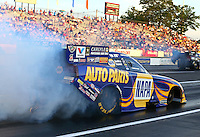 May 31, 2013; Englishtown, NJ, USA: NHRA funny car driver Ron Capps during qualifying for the Summer Nationals at Raceway Park. Mandatory Credit: Mark J. Rebilas-