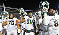29 November 2014:  Michigan State T Donavon Clark (76), DE Shilique Calhoun (89) and NT Lawrence Thomas (8) sing their alma mater and celebrate after the game. The Michigan State Spartans defeated the Penn State Nittany Lions 34-10 at Beaver Stadium in State College, PA.