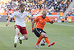 14 JUN 2010:  Wesley Sneijder (NED)(10) oversteps the ball as Martin Jorgensen (DEN)(10) applies pressure.  The Netherlands National Team defeated the Denmark National Team 2-0 at Soccer City Stadium in Johannesburg, South Africa in a 2010 FIFA World Cup Group E match.