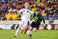 Louisville Cardinals goalkeeper Andre Boudreaux (30) denies Steven Perry (11) of the Notre Dame Fighting Irish. The Louisville Cardinals defeated the Notre Dame Fighting Irish 1-0 during the semi-finals of the Big East Men's Soccer Championship at Red Bull Arena in Harrison, NJ, on November 12, 2010.
