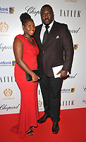 guest and Nonso Anozie at the Lux Afrique gala dinner, Claridge's Hotel, Brook Street, London, England, UK, on Sunday 01 October 2017.<br /> CAP/CAN<br /> &copy;CAN/Capital Pictures