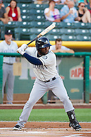 Abraham Almonte (8) of the Tacoma Rainiers at bat against the Salt Lake Bees in Pacific Coast League action at Smith's Ballpark on July 8, 2014 in Salt Lake City, Utah.  (Stephen Smith/Four Seam Images)