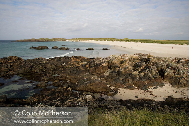 The rocky foreshore and sandy beach at Balevullin Bay on the island of Tiree on Scotland's west coast. The island is famous for its annual surfing events which attracts thousands of visitors to the small Hebridean island. Tiree has an area of 30 square miles (78 km2) and a population of around 800.