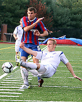 Pat Healey #9 of Crystal Palace Baltimore has the ball taken away from him by David Testo #7 of the Montreal Impact during an NASL match at Paul Angelo Russo Stadium in Towson, Maryland on August 21 2010. Montreal won 5-0.