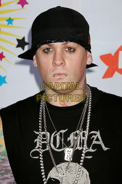 GOOD CHARLOTTE.BENJI MADDEN.Nickelodeon's 19th Annual Kids' Choice Awards - Orange Carpet at the Pauley Pavilion,  Westwood, California, .USA, 1st April 2006..half length black tattooes hat .Ref: ADM/RE.www.capitalpictures.com.sales@capitalpictures.com.©Russ Elliot/AdMedia/Capital Pictures.