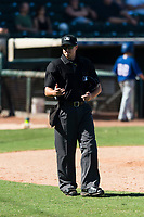 Home plate umpire Brennan Miller during an Arizona Fall League game between the Surprise Saguaros and the Peoria Javelinas at Surprise Stadium on October 17, 2018 in Surprise, Arizona. (Zachary Lucy/Four Seam Images)