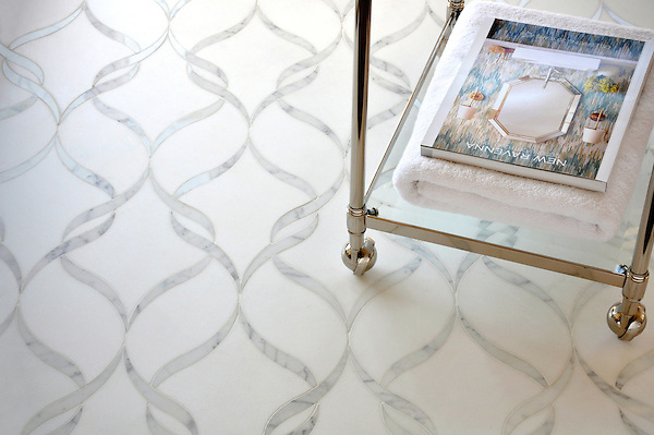 Sophie, a handmade mosaic shown in polished waterjet-cut Calacatta Tia and honed Thassos, is part of the Silk Road Collection by Sara Baldwin for New Ravenna.<br />