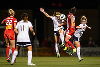 Sky Blue FC midfielder Ashley Nick (12) goes up for a header with Western New York Flash forward Abby Wambach (20). The Western New York Flash defeated Sky Blue FC 2-0 during a National Women's Soccer League (NWSL) semifinal match at Sahlen's Stadium in Rochester, NY, on August 24, 2013.