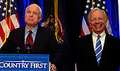 A lighter moment: Senators John McCain (left) and Joe Lieberman have a light hearted moment during the press conference at the Townsend Hotel in Birmingham Wednesday.