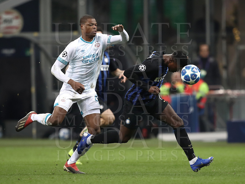Football: UEFA Champions League -Group Stage - Group B - FC Internazionale Milano vs PSV Eindhoven, Giuseppe Meazza  (San Siro) Stadium, Milan Italy, December 11, 2018.<br /> Inter Milan's Keita Bald&eacute; (r) in action with PSV Eindhoven's Denzel Dumfries (l) during the Uefa Champions League football match between Inter Milan and PSV Eindhoven at Giuseppe Meazza  (San Siro) Stadium in Milan on December 11, 2018. <br /> UPDATE IMAGES PRESS/Isabella Bonotto