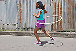 "Girl with hula hoop - part of the Tobago Heritage Festival parade at  Mason Hall ""Games we used to play"" parade, Tobago"
