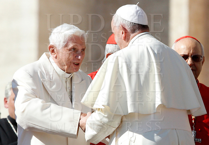 Papa Francesco saluta il Papa Emerito Benedetto XVI in occasione dell'incontro internazionale con gli anziani e i nonni, in Piazza San Pietro, Citta' del Vaticano, 28 settembre 2014.<br /> Pope Francis greets Pope Emeritus Benedict XVI on the occasion of the international meeting with elderly and grandparents in St. Peter's square at the Vatican, 28 September 2014.<br /> UPDATE IMAGES PRESS/Riccardo De Luca<br /> <br /> STRICTLY ONLY FOR EDITORIAL USE