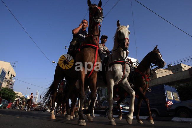 A Palestinians ride camels and horses during a demonstration calling for Palestinian unity, in Gaza City on July1, 2009.  photo by Wissam Nassar