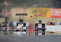 Oct. 6, 2012; Mohnton, PA, USA: NHRA top fuel dragster driver Rit Pustari (right)  crosses the centerline and heads towards Clay Millican during qualifying for the Auto Plus Nationals at Maple Grove Raceway. Mandatory Credit: Mark J. Rebilas-
