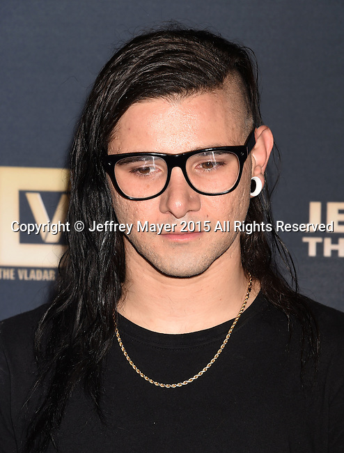 HOLLYWOOD, CA - SEPTEMBER 08: DJ/singer/songwriter Skrillex arrives at the Premiere Of The Vladar Company's 'Jeremy Scott: The People's Designer' at TCL Chinese 6 Theatres on September 8, 2015 in Hollywood, California.