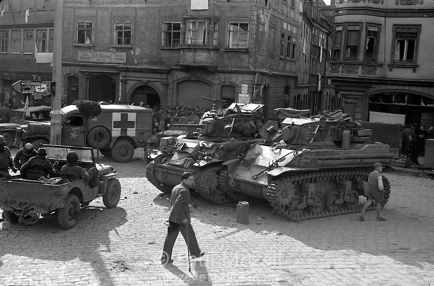 American tanks stand guard in the square of German town shortly after occupation by American troops. April 1945