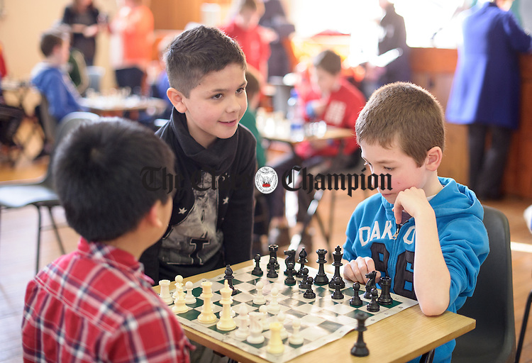 Conor Mac Cormaic  of Shannon, right, ponders his next move at the Clare Community games chess county finals in St Flannan's college, Ennis. Photograph by John Kelly.