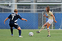 27 August 2011:  FIU's Marie Egan (13) passes the ball as Akron's Ashley Hughes (7) defends in the first half as the FIU Golden Panthers defeated the University of Arkon Zips, 1-0, at University Park Stadium in Miami, Florida.