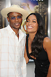 "WESTWOOD, CA - JULY 06: Tommy Davidson and Rosario Dawson arrive to the ""Zookeeper"" Los Angeles Premiere at Regency Village Theatre on July 6, 2011 in Westwood, California."