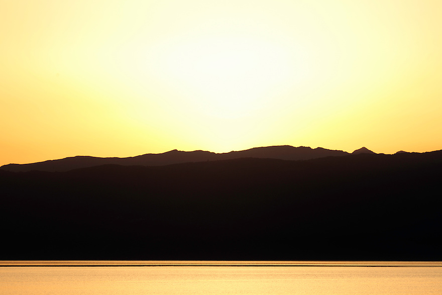 Sunset over Lake Ohrid, Macedonia and the Mokra Pl mountain range in Albania. View west across Lake Ohrid from Lagadin area Galicica National Park. Lake Ohrid (693m).<br /> Galicica National Park, Macedonia, June 2009<br /> Mission: Macedonia, Lake Macro Prespa /  Lake Ohrid, Transnational Park<br /> David Maitland / Wild Wonders of Europe