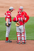 Joe Bircher (31) of the Bradley Braves talks with the pitching coach on the mound during a game against the Missouri State Bears on May 13, 2011 at Hammons Field in Springfield, Missouri.  Photo By David Welker/Four Seam Images