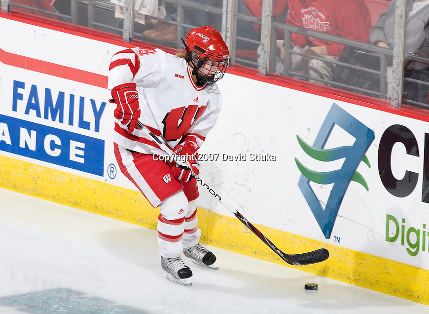 MADISON, WI - NOVEMBER 2: Mallory Deluce #9 of the Wisconsin Badgers women's hockey team handles the puck against the Minnesota Golden Gophers at the Kohl Center on November 2, 2007, in Madison, Wisconsin. The Badgers beat the Golden Gophers 3-0. (Photo by David Stluka)