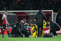 The medical team from Oxford and Brentford attend to the injured Shandon Baptiste of Oxford United during Brentford vs Oxford United, Emirates FA Cup Football at Griffin Park on 5th January 2019