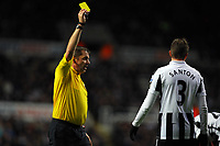 Saturday 17 November 2012<br /> Pictured: Davide Santon of Newcastle (R) sees a yellow card by match referee Phil Dowd (L)<br /> Re: Barclay's Premier League, Newcastle United v Swansea City FC at St James' Park, Newcastle Upon Tyne, UK.