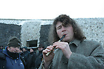 Newgrange Co Meath, 21th December winter solstice, No sun rise this year but a blanket of snow decended on the Tomb in Co Meath. Aonghus Óg playing the tin whistle..Picture Fran Caffrey /www.newsfile.ie.