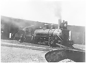 3/4 view of K-27 #450 at roundhouse in Gunnison?  Several men on train, one with dog.<br /> D&amp;RGW  Gunnison, CO
