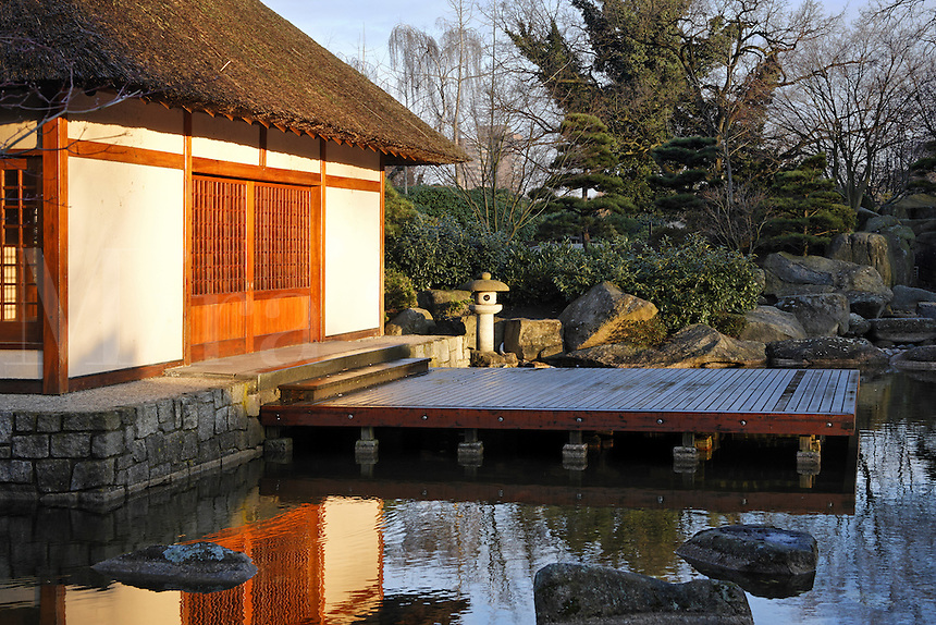 Tea house beside pond in Japanese Garden designed by landscape architect Joshikuni Araki in Hamburg's Planten un Blomen park, Germany<br />
