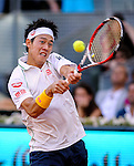 "Japanese tennis player Kei Nishikori during his men's singles final tennis match against Spanish tennis player Rafael Nadal at the Madrid Masters at the ""Caja Magica"" sports complex in Madrid on May 11, 2014.<br /> <br /> Photocall3000/Daniel Calleja"