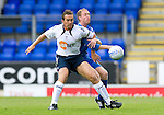 St Johnstone v Bolton....02.08.10  Pre-Season Friendly.Kevin Davies battles with Steven Anderson.Picture by Graeme Hart..Copyright Perthshire Picture Agency.Tel: 01738 623350  Mobile: 07990 594431