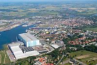 MTW Wismar:EUROPA, DEUTSCHLAND, MECKLENBURG- VORPOMMERN 29.06.2005 MTW ist die Kurzbezeichnung für die Aker MTW Werft Wismar, früher VEB Mathias-Thesen-Werft Wismar. .Am 27. April 1946 wurde in Wismar ein Schiffsreparaturwerk der Roten Armee gegründet, welches am 1. Januar 1947 an die DDR übergeben wurde. .In den Folgejahren wurde eine vielzahl von Hochseeschiffen für die Handelsflotten der DDR, anderer Länder des RGW und den internatinalen Markt gefertigt..1982-1985 fanden umfangreiche Modernisierungen statt, um die Werft den aktuelllen technischen Stand zu bringen..Im Zuge der Wirtschaftsreformen in der DDR wurde am 1. Juni 1990 die Mathias-Thesen-Werft Wismar GmbH gegründet. MTW gehört jetzt zur Deutsche Maschinen und Schiffbau AG (DMS). Nach der Umbenennung in MTW Schiffswerft GmbH, MTW jetzt für Meerestechnik Wismar, folgt im August 1992 die Übernahme durch Bremer Vulkan Verbund AG...Am 1. Mai 1998 übernimmt der norwegische Aker-Konzern die Werft, welche seitdem den Namen Aker MTW Werft Wismar trägt..Heute beschäftigt die Werft 1.300 Mitarbeiter, und ist so der mit Abstand größte Arbeitgeber Wismars. Zu den neu gebauten Anlagen in Wismar gehört auch das erste überdachte Dock Deutschlands, ein 72 m hohes und über 395 m langes Bauwerk.. Aufbau Ost, Gewerbe Industrie, Schiffbau.Luftaufnahme, Luftbild,  Luftansicht.c o p y r i g h t : A U F W I N D - L U F T B I L D E R . de.G e r t r u d - B a e u m e r - S t i e g 1 0 2, .2 1 0 3 5 H a m b u r g , G e r m a n y.P h o n e + 4 9 (0) 1 7 1 - 6 8 6 6 0 6 9 .E m a i l H w e i 1 @ a o l . c o m.w w w . a u f w i n d - l u f t b i l d e r . d e.K o n t o : P o s t b a n k H a m b u r g .B l z : 2 0 0 1 0 0 2 0 .K o n t o : 5 8 3 6 5 7 2 0 9.C o p y r i g h t n u r f u e r j o u r n a l i s t i s c h Z w e c k e, keine P e r s o e n l i c h ke i t s r e c h t e v o r h a n d e n, V e r o e f f e n t l i c h u n g  n u r  m i t  H o n o r a r  n a c h M F M, N a m e n s n e n n u n g  u n d B e l e g