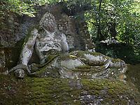 Bomarzo, Viterbo - Parco dei Mostri o Sacro Bosco, complesso monumentale realizzato nel 1547con grandi sculture di figure mitologiche del genere grotesque. Nettuno<br /> Bomarzo, Viterbo - Monster Park or Sacro Bosco, a monumental complex built in 1547 with large sculptures of mythological figures such grotesque. Neptune
