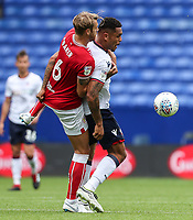 Bolton Wanderers' Josh Magennis holds off Bristol City's Nathan Baker<br /> <br /> Photographer Andrew Kearns/CameraSport<br /> <br /> The EFL Sky Bet Championship - Bolton Wanderers v Bristol City - Saturday August 11th 2018 - University of Bolton Stadium - Bolton<br /> <br /> World Copyright &copy; 2018 CameraSport. All rights reserved. 43 Linden Ave. Countesthorpe. Leicester. England. LE8 5PG - Tel: +44 (0) 116 277 4147 - admin@camerasport.com - www.camerasport.com