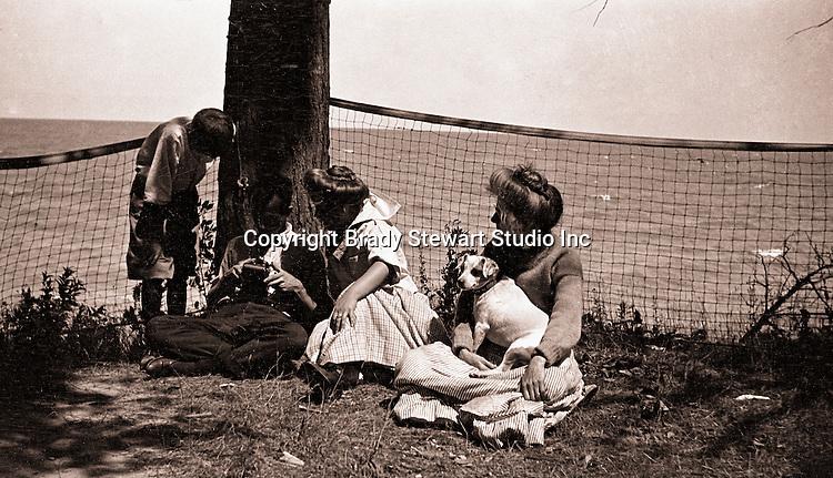 North East PA:  A view of Brady Stewart working on his camera while Homer, Helen, Alice and Peppy watch.   During the early 1900s, the Stewart family vacationed on Lake Erie near North East Pennsylvania. Since hotels and motels were non-existent, camping was the only viable option for a large number of vacationers
