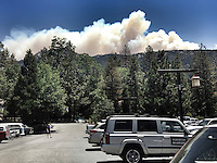 Fire plumes from the Mountain Center fire as seen from the center of Idyllwild, the Post Office parking lot on July 16, 2013.